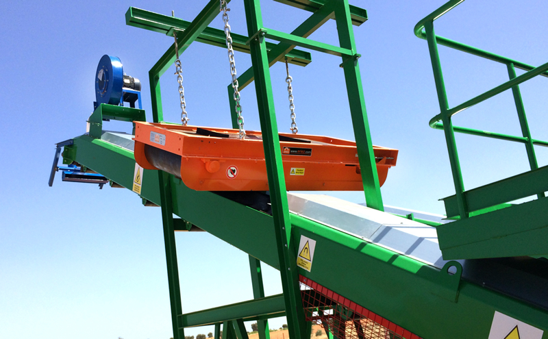 Automatically remove small to general size tramp iron from non-ferrous materials conveyed on almost any type of conveyor